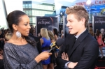123010_access-hollywoods-shaun-robinson-gets-the-scoop-from-xavier-samuel-on-the-eclipse-black-carpet-la-ju