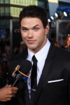 123032_kellan-lutz-raises-his-eyebrow-as-he-talks-with-access-hollywood-at-the-eclipse-premiere-la-june-24-