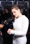 123041_kristen-stewart-checks-her-sleeve-as-she-talks-eclipse-premiere-fashion-with-access-la-june-24-2010